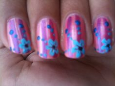 Blue flower and dots over pink and purple stripes/ nail art