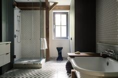 Metro modern style. Graphic patterned Floor  with white Wall tiles & black painted Wall panels.