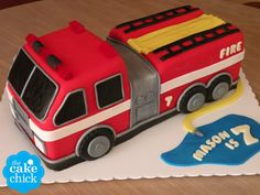 Fire Truck Birthday Cake custom sculpted fire truck shaped cake for a 7th birthday.