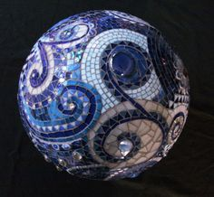 like the combingation of tiles and glass gems, and like the spirals, especially with small/regular tesserae