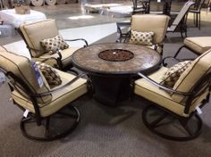 Propane fire-pit with four comfy chairs, Ceramic table top.