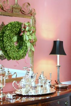 Holiday Boxwood Wreath Above Silver Service on Sideboard