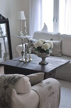 ❤ Cottage Chic Living Room. Cherie this is beautiful! Linen, silver candleticks, sheer curtains...love!