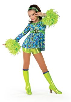 13032 - Girl Power - Travel back in time with this royal blue and lime green print tunic with attached silver flecked feather boa trim and sequin flower.