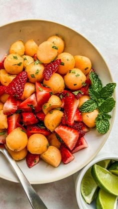 This easy strawberry cantaloupe salad recipe with a sweet mint and lime topping is wonderfully delicious. It's a perfect side dish to serve at a summer dinner.
