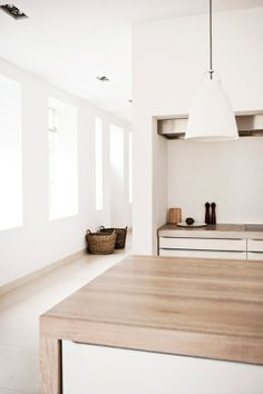 Swedish | White | Minimalist - love the wrap round worktop extending down to the floor covering the cabinet ends