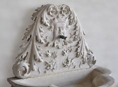 Rare carved stone wall fountain with Green Man and dolphins decor #18thcentury #fountain #gardenantiques #frenchantiques #grotesques #decor #antique Available on #MarcMaison 's website
