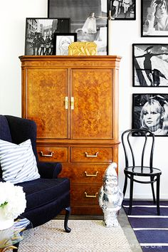 Before and After: Our Co-Founder Hillary Kerr's Rockstar Office Transformation // offices, workspaces, black and white photography, black velvet wing chair, bentwood chair, antique armoire, striped rug, silver gnome, sisal rug