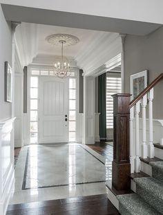 Entryway, marble floor, chandelier, door/windows