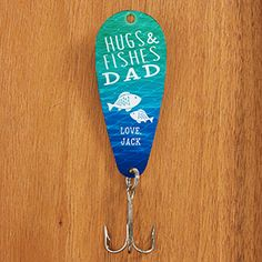 "This is such a cute Father's Day gift idea for Dads who love to fish! It's the Personalized ""Hugs & Fishes"" Father's Day Fishing Lure! It comes in a bunch of colors and cute fishing sayings that you can choose from! LOVE it!"