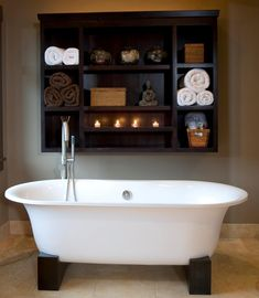 Master Bath inspiration, shelf above tub with towels, accessories