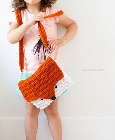 What does the fox say? A fun and bright orange and white fox purse by 1DogWoof - make it with Lion Brand Vanna's Choice!