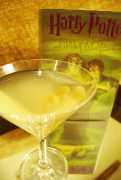 Draco Malfoy  Ingredients:  2 oz gin  1 tbsp dry vermouth  2 tbsp olive juice  2 gruyere stuffed olives  Directions:  Fill cocktail glass with cold water and place in freezer for 2 minutes to chill.  Fill a cocktail mixer with gin, Vermouth and olive juice. Cover and shake.  Remove glass from freezer, empty and strain mixer into the cocktail glass.  Garnish with olives.