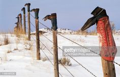 Winter Cowboy Boots On Fence Posts