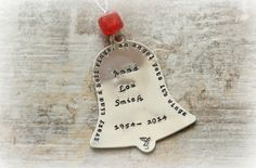 Memory Bell personalized ornament Every time a bell rings an angel gets its wings stamped with loved ones name and birth and death years