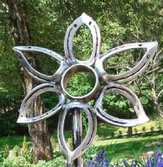 Recycled Horseshoes Garden Sculpture Mark your product with your very own custom R-Buster handstand http://columbiamt.com/CMT-Main/