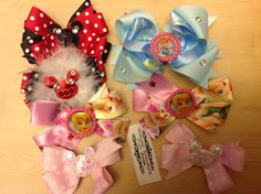Any choice bows from $6 and up.  Www.facebook.com/sammybananyshairbows  Minnie, Minnie Mouse, Mickey Mouse, big bows, Disney world, hair bows, medium bows, feathers, how to make, lilac, purple black, sequins, tinkerbell, Cinderella, princess, bottle caps, resins, bows