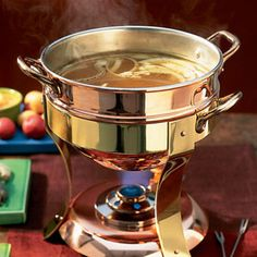 Bouillabaisse broth for fondue, lean meat fondue sounds like a healthy date night meal.