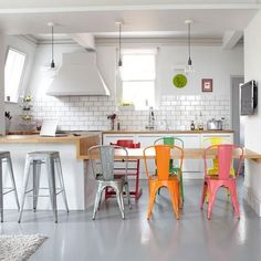 Love the colorful chairs in this kitchen