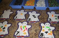halloween theme ideas and printables (halloween beginning sounds, sensory table, letter/color/number candy corn match, etc)