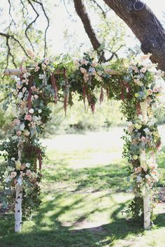 Textural florals and foliage on a chuppah.