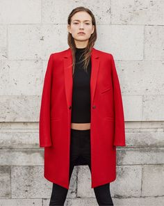 Model wears coats for Winter 2015 lookbook photoshoot