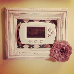 Thermostat picture frame. Helps your thermostat blend into your picture collage on your wall. Supplies fron Hobby Lobby 5x7 picture frame, scrap book paper, and burlap flower. $13