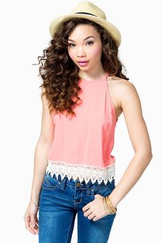 A darling chiffon top featuring crochet trimming and a halter neck. Spaghetti straps. Keyhole back with a self-tie.