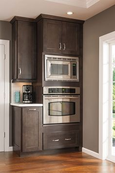 This tall microwave and oven cabinet follows the current trend to move the microwave away from the area over the cooktop and off the countertop.