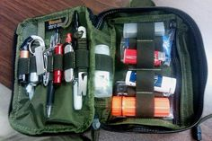 Maxpedition Fatty Pocket Organizer  The list: zip ties batteries nail clippers 2 magnets (never know when youll need them) whistle Aloksak Classic mini pry bar aluminum pill fob pen Sharpie Emergen-C sanitizer waterproof matches Advil Bic razor blade needles thread rubber gloves duct tape  Zippered pouch contains:alcohol preps Neosporin tweezers more Advil Benedryl gauze
