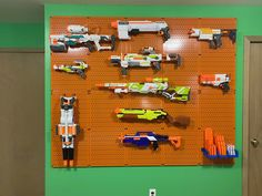 We always get excited about a good Nerf wall! Our hanging bins are great for storing your ammo or other small items. 🔫 Thanks for sharing Brian! Nerf Gun Storage, Metal Pegboard, Tool Organization, Office Walls, Display, Crafting, Floor Space, Billboard