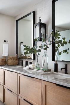 The cool grey tones on the countertops and tiles, paired with the same warm wooden cabinetry we used in the kitchen, played into the spa feeling in this space. Plus black metal hardware, mirrors and light fixtures bring in the modern details from the rest Bad Inspiration, Bathroom Inspiration, Bathroom Inspo, Bathroom Ideas, Spa Bathroom Decor, Bathroom Counter Decor, Spa Inspired Bathroom, Bathroom Vanity Decor, Bathroom Makeovers