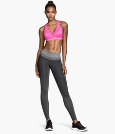 Bright pink athletic bra & dark gray low-rise sports tights with body sculpting effect. | H&M Sport
