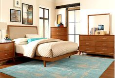It's time to go retro. These Mid-Century inspired bedroom essentials are inspired by the golden age of modern design and style. Create your very own chic space by mixing in wooden accents, bright eye-popping decorations, and lots of clean, sleek lines.http://www.allmodern.com/deals-and-design-ideas/Mid-Century-Bedroom~E16953.html?refid=SBP.rBAZEVSmF3OdtVUb2RrMAgiPDkUtTEoxv8sg8EcZ-RQ