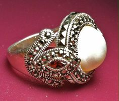 "This beautiful size 9 mother of pearl ring is available on our Etsy shop ""thats2crafty!"" Hurry, only one available!   https://www.etsy.com/listing/186350150/estate-sterling-marcasite-mother-of?ref=shop_home_active_19 SOLD"