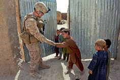 From @Marinetimes: Cpl. Patrick McCall, a rifleman with 1st Battalion, 7th Marines, receives a high-five from an Afghan boy during a security patrol in the Sangin district of Helmand province, Afghanistan, on Sept. 6. The 1/7 is being replaced by elements of 2/7. (Photo by Lance Cpl. Jason Morrison/USMC)