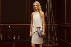 A layered dress and printed leather clutch bag from the BOSS Womenswear collection