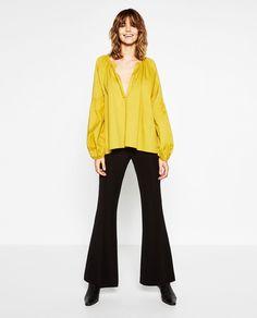 Image 1 de BLOUSE EN COTON AVEC MANCHES AMPLES de Zara