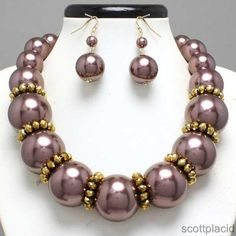 "CHUNKY BROWN FAUX PEARL GOLD TONE METAL NECKLACE SET     * If you need a necklace extender I have them for sale in my store.*        NECKLACE: 17"" + 3"" EXT    CHARM: 1"" LONG    LOBSTER CLAW CLOSURE       HOOK EARRINGS: 2"" LONG           COLOR: GOLD TONE  $23.99"