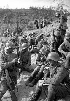 Red Army in Mongolia wearing 36 pattern steel helmets, also eating bananas.