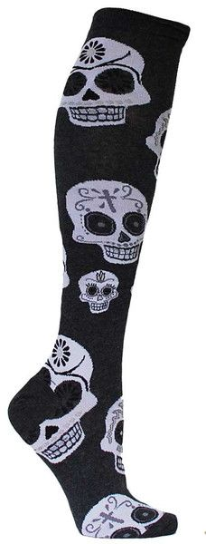 Charcoal knee high length socks with large white Dia de los Muertos skulls. Fits women's shoe size 5-10.