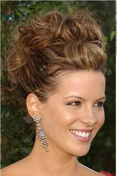 This stylish updo has so much volume. What a hairstyle this is as it is sexy and romantic. This would look great for a wedding or a prom. The hair is long and has all been gathered together into this incredible style. There is a glow about the whole thing.This haircut is very long.Kate's hair colouring of choice is a gorgeous chocolate brown colour.