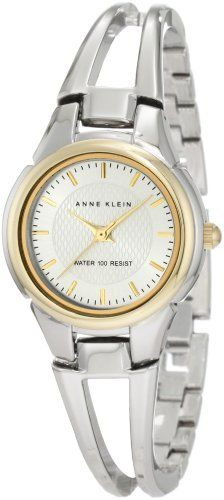 Anne Klein Women's 10/9817SVTT Two-Tone Bangle Watch Anne Klein. $39.99. Water-resistant up to 100 ft.. Gold-tone hour, minute and second hands. Silver-tone open bangle with adjustable link backing. Silver-tone dial with gold-tone hour markings. Silver-tone 27mm round case with polished gold-tone bezel. Save 27% Off!