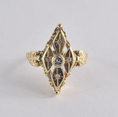 This twinkling romantic ring has etching down the sides.  A beautiful original 14 karat yellow gold antique diamond ring.