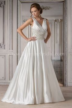 Jasmine Bridal Couture Style T172065  in Ivory // Be a vision of grandeur dressed in a Silky Satin ball gown. A ruched V-neckline leads down to a heavily beaded waistline and ends in a clean, smooth satin skirt. The back of this wedding dress features a plunging backline with hand-beaded straps.