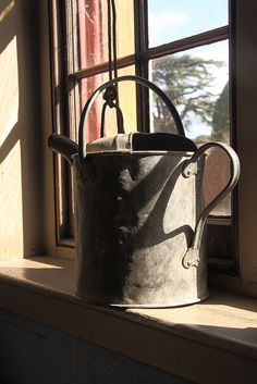 watering can on the windowsill