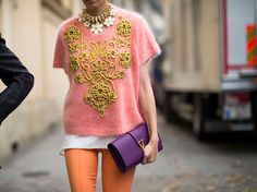 "There is SOOOO much going on in this Spring 2013 Paris Fashion Week street style photo: statement necklace, YSL ""IT"" clutch, baroque, colorful pants. But she's making it WORK!"