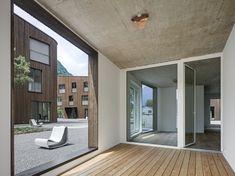 Geviert - Wohnüberbauung in Näfels Concrete Ceiling, Garden Styles, Interior Architecture, Awards, Garage Doors, Windows, Flooring, The Originals, Outdoor Decor