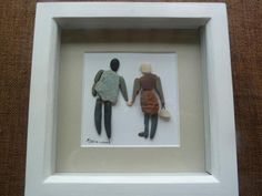 Framed picture of couple holding hands made with pebbles - available to buy now on Exhibit Cornwall; the online showcase for the finest art, craft and creative talent that Cornwall has to offer.