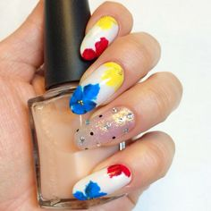 Get that summer freshness with your nails by donning this white based and colorful ensemble of blue, red and yellow nail art. Match it with your favorite beach outfit and you will look absolutely summer fresh and ready!